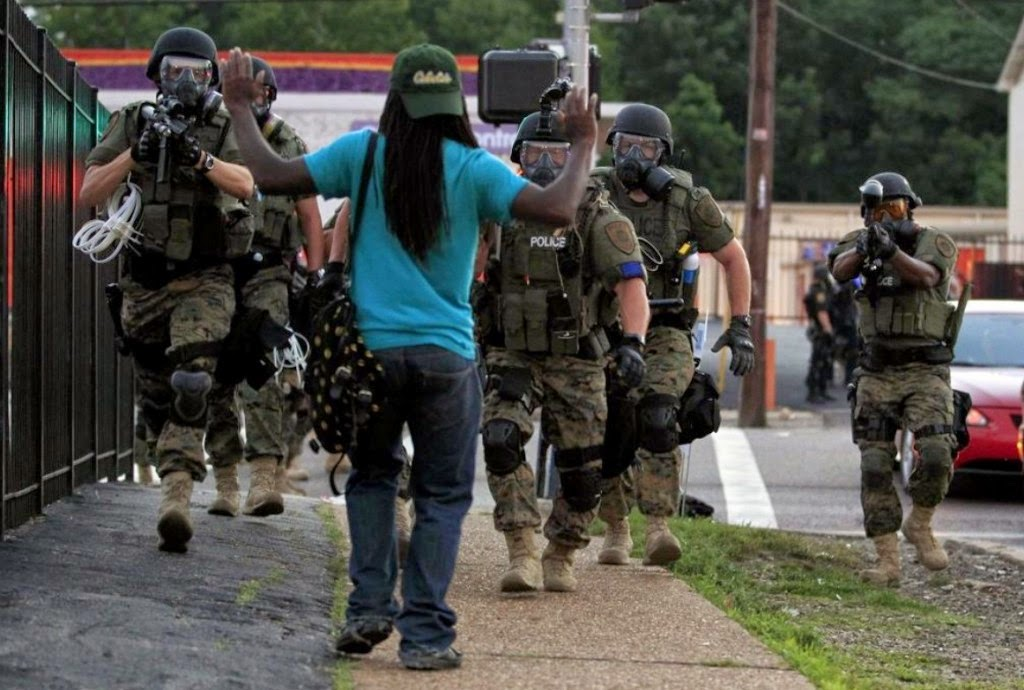 Paramilitary Police Draw Down on Man in Ferguson, Missouri