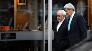 U.S. Secretary of State John Kerry, right, speaks with Iranian Foreign Minister Mohammad Javad Zarif in Geneva, Switzerland, in January. Kerry will meet again with Zarif this weekend in the Swiss capital as March deadline approaches. (Keystone/ Martial Trezzini/file/Associated Press)